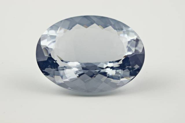 Oval-cut blue opal weighing 20.9 ct.