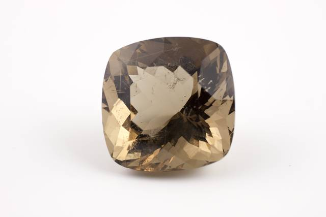 Square cushion-cut gray brown petalite weighing 25.2 ct.