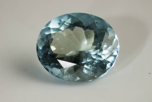 Oval-cut blue afghanite weighing 0.6 ct.