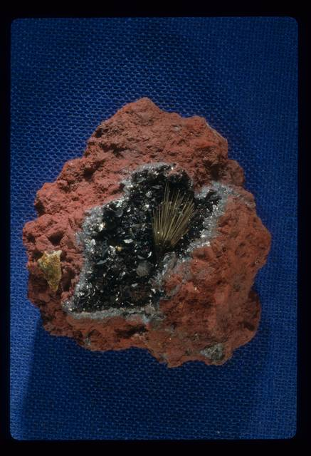 Millerite with hematite and quartz from Jefferson Co., New York, United States