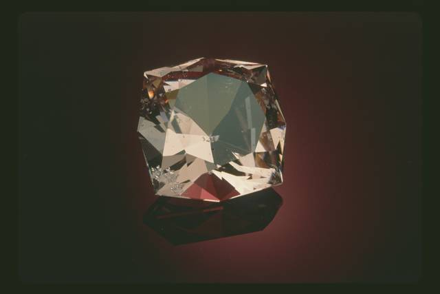 Modified square brilliant-cut gray light red purple beryl (var. morganite) weighing 82.83 ct.