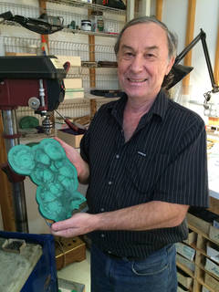Nicolai Medvedev with some of his favorite rough – malachite. Photo by Christine Webb.