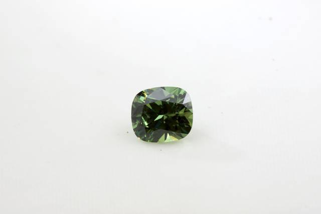 Cushion cut 3.00ct demantoid gem.
