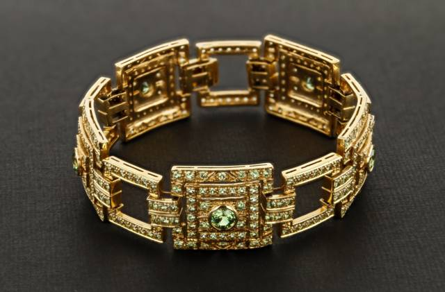 This yellow gold bracelet has round cut dematoid garnets from the Green Dragon Mine in Namibia. Unlike Russian demantoids, these gems have a more yellowish-green color.