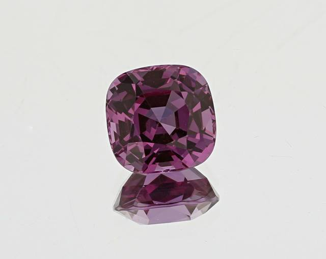 This fancy cushion cut rhodolite from Tanzania is unique due to its pinkish-purple color and locality.