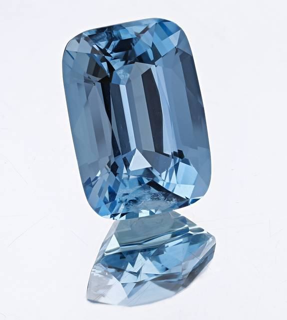 This modified cushion cut gem, exhibiting a vibrant blue color, is from Minas Gerais, Brazil.