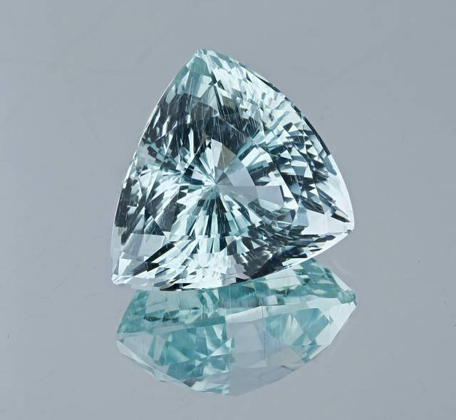 This triangular cut aquamarine exhibits an icy blue color and is the first aquamarine from Pakistan for the National Gem Collection.