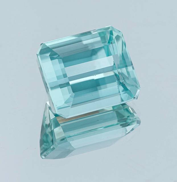 Transparent amblygonite is commonly colorless to light yellow. This modified emerald cut gem is a beautiful greenish-blue color, making it a rare and important addition to the National Gem Collection.