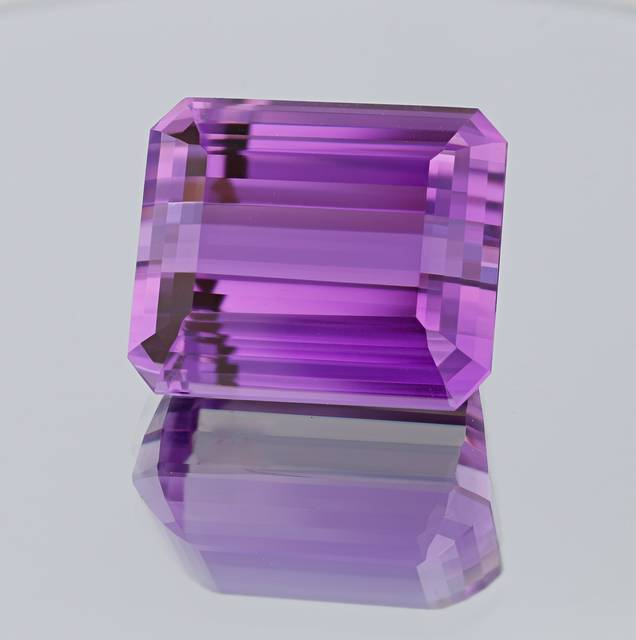 This exceptional modified step-cut gem has a vibrant deeply saturated pinkish-purple color and is from a 2010 find at the Oceanview Mine in Pala, CA.
