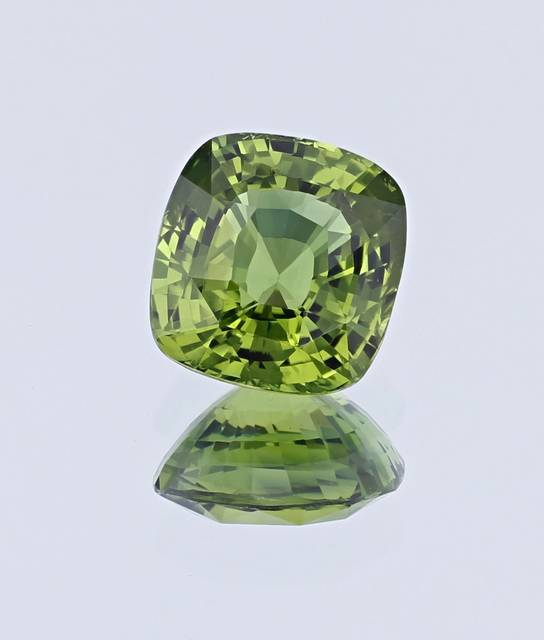 This cushion cut sapphire from Madagascar weighs 7.41ct, exhibiting a slightly yellowish-green color, and is an upgrade for the National Gem Collection.