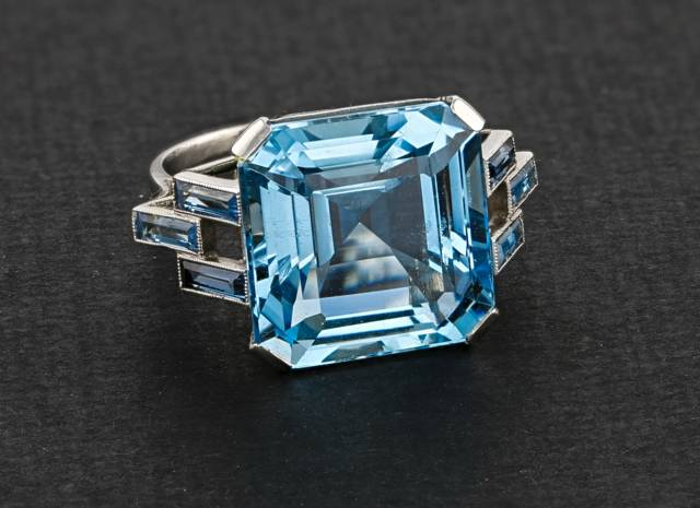 This Art Deco platinum ring featuring an intense blue square-cut aquamarine was once in the collection of Annie Cullinan. She was the wife of Thomas Cullinan, owner of the Premier Mine in South Africa, now named the Cullinan Mine, from which the famous Cullinan Diamond was found in 1905.