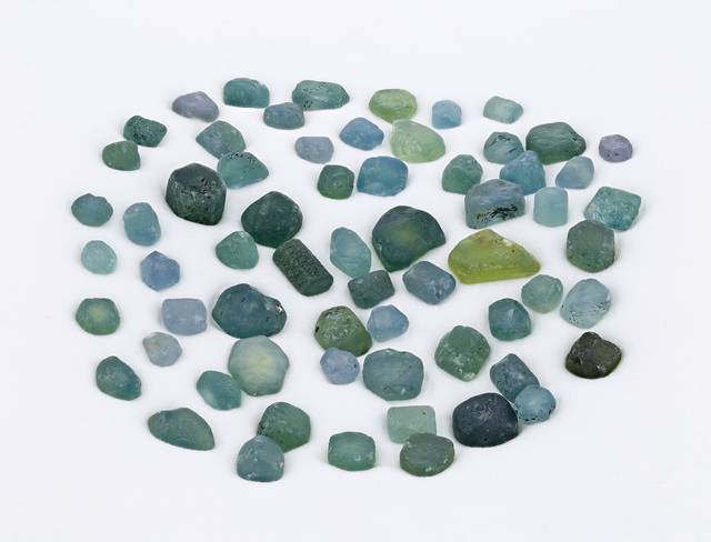 Natural (unheated/untreated) sapphire crystals from an important historic mining area in the U.S., the Missouri River deposit of Montana, range in varying colors of green to blue. This collection of natural sapphire crystals of substantial size and fine color are a major upgrade to the National Mineral Collection.