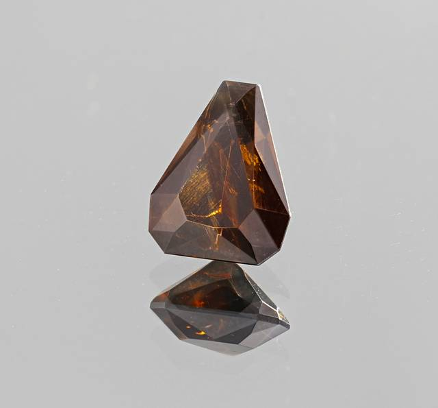 Phosgenite is a very rare gem that is extremely soft. This fancy cut stone is the first phosgenite in the National Gem Collection.