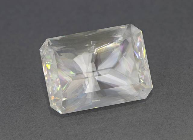 This 293ct calcite gem from Mexico is a modified step-cut faceted by Michael Gray. It displays the double refraction and dispersion typical of this mineral. It is the largest calcite from Mexico in the National Gem Collection.