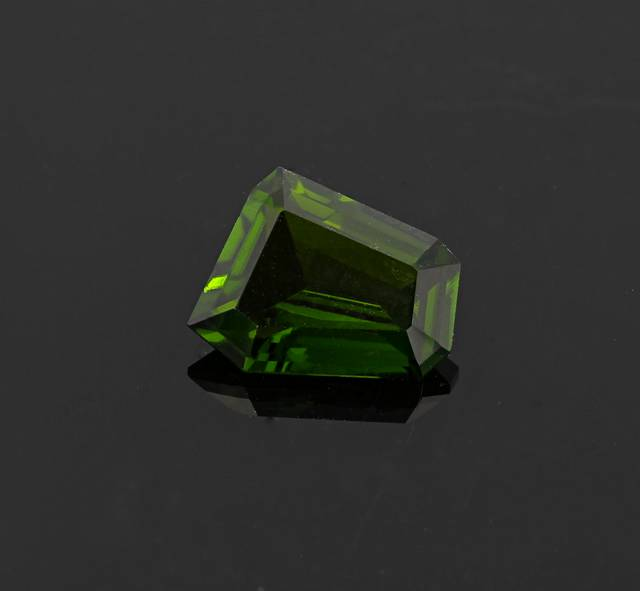 Chrome diopside resembles the color of  tsavorite garnet, chrome tourmaline, and emerald. It is typically seen in small sizes (under 3 carats) because in larger sizes the color tends to become very dark, almost black.