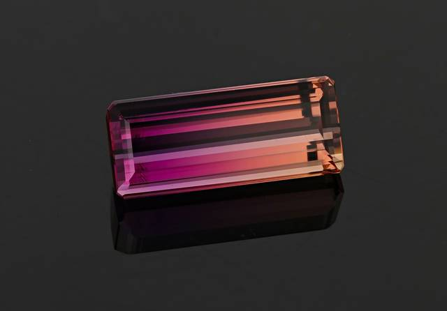 This bi-color topaz is unique as it ranges from salmon to violet-pink in color.
