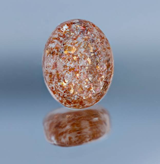 The golden sheen flashing off of this sunstone is due to the presence of hematite platelet inclusions. This gem is the first sunstone from Tanzania in the National Gem Collection.