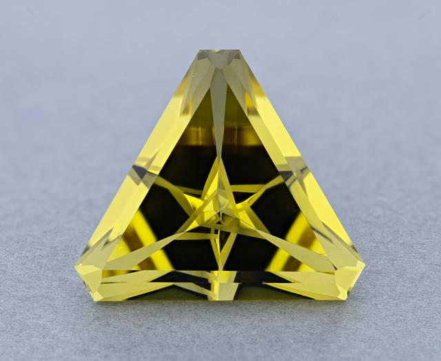 This gem is faceted in a Turkish star having the effect of facets reflecting off of each other. This heliodor is from a locality not previously represented in the National Gem Collection.