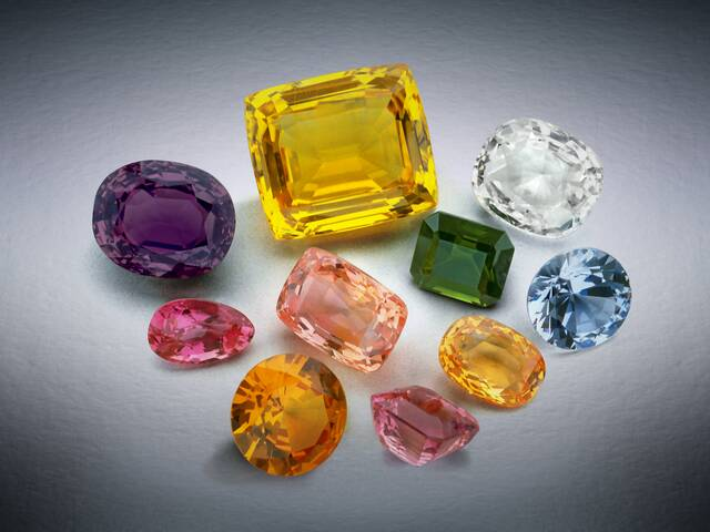 Photograph of a group of sapphires from the National Gem Collection showing color variation