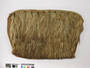 1 A PLAITED BELT, OR KILT OF ROUGHLY SCUTCHED FLAX...